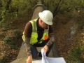 Sebastian Paris consults blueprints along the Middle Blue River to ensure we inventory all required trees properly.